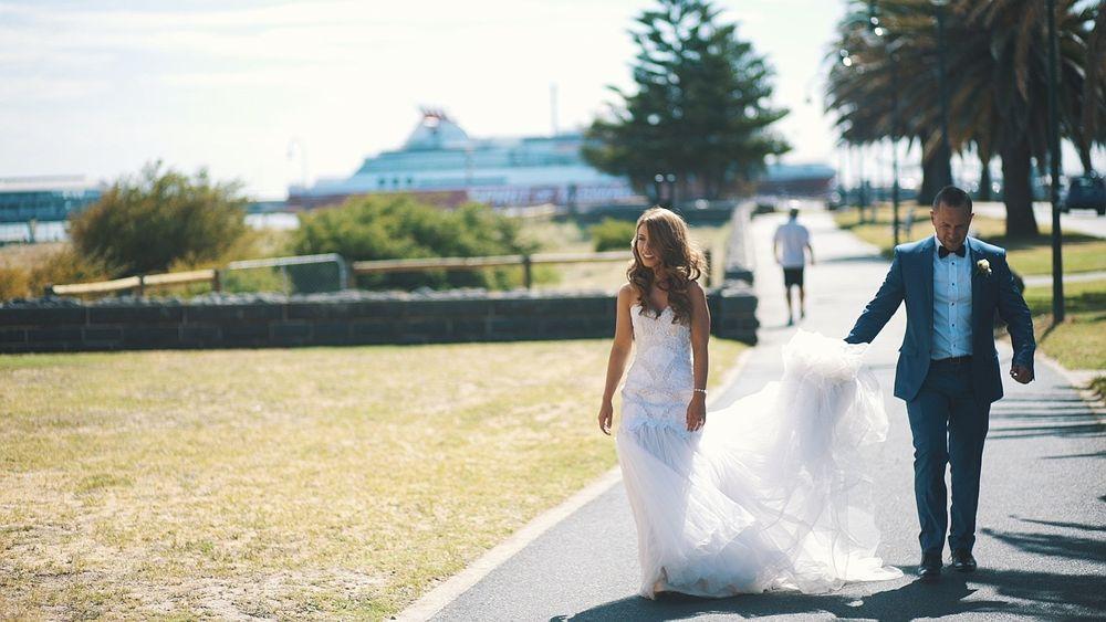 wedding bride and groom walking in the park