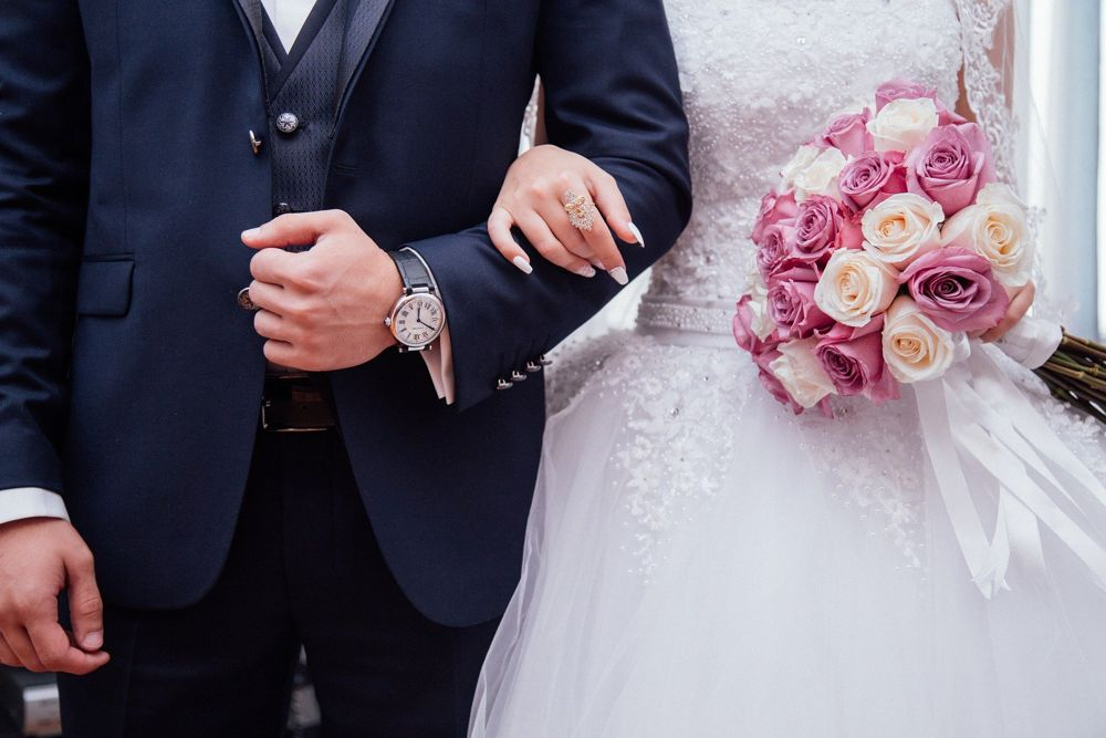 wedding bride with groom holding hands