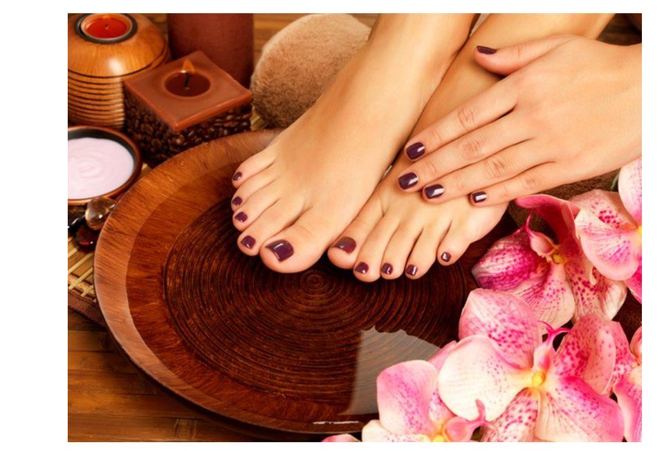 closeup photo female feet spa salon pedicure procedure female legs water decoration flowers
